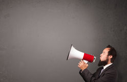 Guy shouting into megaphone Stock Photo