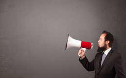 Guy shouting into megaphone Royalty Free Stock Photo