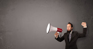 Guy shouting into megaphone Stock Photos