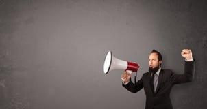 Guy shouting into megaphone Stock Photos