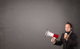 Guy shouting into megaphone on copy space Royalty Free Stock Photos