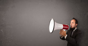 Guy shouting into megaphone Royalty Free Stock Photography