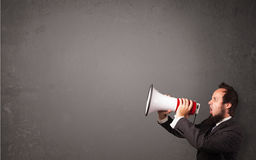 Guy shouting into megaphone Stock Images