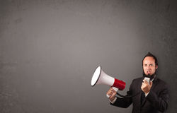 Guy shouting into megaphone. On copy space background Stock Photography
