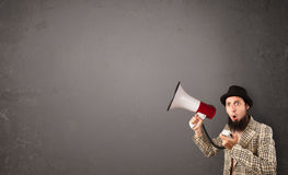 Guy shouting into megaphone on copy space Royalty Free Stock Photo
