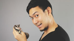 A guy showing his pet. An asian man with black t-shirt stock image