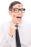 Guy showing the lipstick kiss marks on his face Royalty Free Stock Image