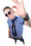 Guy showing okay sign. Modern young guy showing okay sign - high angle view Royalty Free Stock Photography