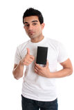Guy showing product thumbs up Royalty Free Stock Image