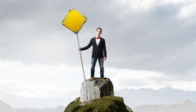 Guy showing roadsign . Mixed media Royalty Free Stock Photography