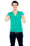 Guy showing thumbs up, arms stretched out Royalty Free Stock Image
