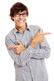 Guy showing two directions. Young hispanic man wearing blue checkered shirt and black glasses showing two directions with his index fingers and smiling isolated Stock Images