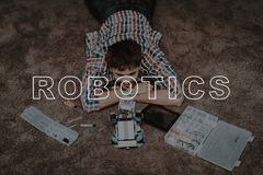 Guy. Sit. Floor. Robot Rhino. Parts. Tool. Tablet. stock image