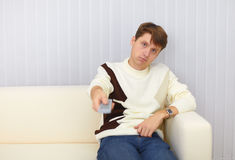 Guy sits on sofa and watches TV Stock Images