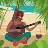 Guy sitting on a beach, plays guitar and sings Royalty Free Stock Photo