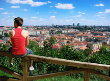 A guy sitting on a fence Stock Photo