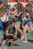 Guy sitting on his haunches. The festival of colors Holi in Cheboksary, Chuvash Republic, Russia. 05/28/2016 Stock Photo