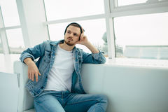 Guy is sitting on sofa and thinking Stock Images