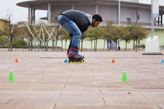 Guy skating in-line with cones. In Zaragoza, Spain Royalty Free Stock Photos