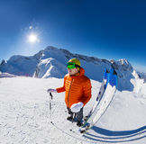 Guy with ski near in snow during sunny winter day Royalty Free Stock Photo
