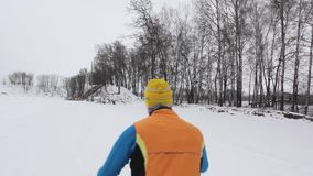Guy skier on a ski base in a snowy forest stock video footage