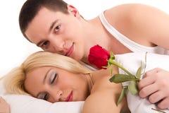 Guy and Sleeping Beauty Royalty Free Stock Photo