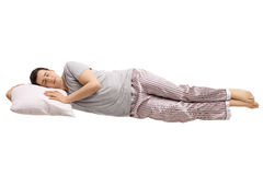 Guy sleeping on a pillow and floating. Isolated on white background Stock Photo