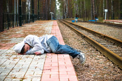 The guy sleeps expecting a train Stock Images