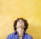 Guy smiling. Facial expressions: guy with curly hair smiling Stock Image