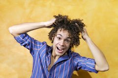 Guy smiling. Facial expressions: guy with curly hair smiling Stock Photography