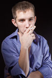 Guy smokes Royalty Free Stock Photo