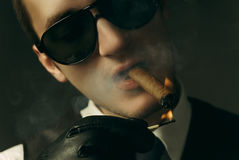 Guy smoking cigar Royalty Free Stock Image