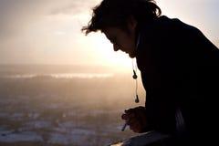 Guy smoking on terrace Stock Photo