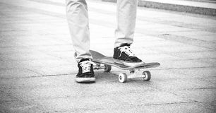 The guy in the sneakers put his foot on the skateboard Royalty Free Stock Photo