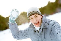 Guy with snowball Stock Images