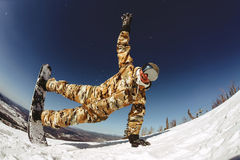 A guy snowboarder enjoys a holiday at the ski resort Stock Images