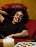 Guy on sofa. Nice guy smiling stock photos