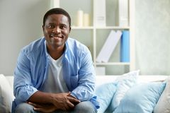 Guy on sofa Royalty Free Stock Photos