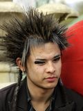 A guy with spiked hair