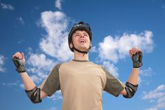 Guy in sports helmet with rised hands Royalty Free Stock Photos