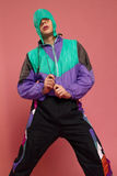 A guy in a sports suit posing on a pink background Royalty Free Stock Photos