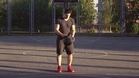 Guy standing at sports ground. stock video