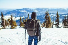 The guy is in the mountains in the winter Royalty Free Stock Image