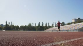 Guy starting to run, gaining speed to win competition for championship, sports stock footage