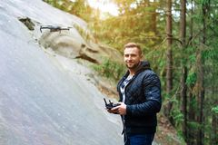 Guy starts a quadrocopter in the forest Stock Images