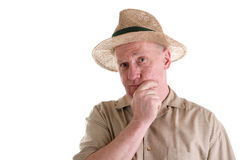 Guy in Straw Hat with Hand on Chin Stock Photos