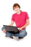 Guy student sits there and works on a laptop Stock Photos