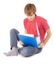 Guy student sitting and reading the documents Stock Images