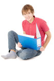 Guy student sitting and reading the documents Royalty Free Stock Photography
