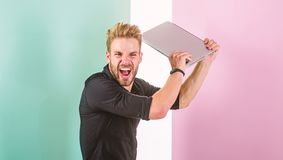 Guy stylish appearance going mad while works laptop. Annoying advertisement promoting brands on internet makes people go. Crazy angry aggressive. Man laptop royalty free stock image
